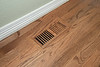Heater vent covers were upgraded from the standard steel type to matching, finished hardwood.