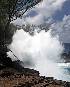 Wave crashes onto Hawii shore