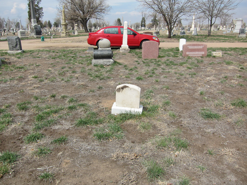 I find this a sorry sight and resolve to make a few modest repairs. Also buried somewhere in this plot, and without headstones, are my great-uncle, J.W. Barron, listed in the book of the original Colorado Pioneers, and his two wives, Eliza and Mary.<br />   The current owners of the cemetery claim they can no longer afford upkeep so they have stopped watering and all but the most basic maintenance. The desert is reclaiming this land