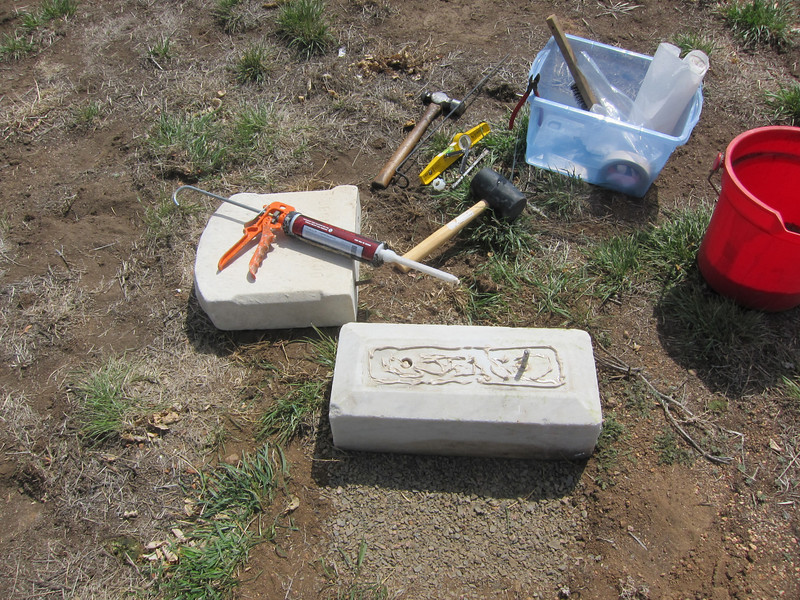 Once the site is prepared and the headstone base stabilized, I get ready to add the headstone itself. First, I remove corrosion and dirt from the stones and locating pins with a steel brush. Once the surfaces are clean I open the $34.00 tube of space age epoxy and get ready to glue the top to the bottom.