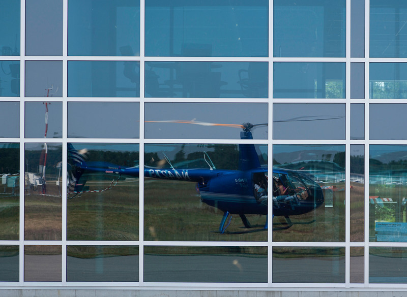 Self Portrait - As we were landing, I noticed the reflection of our chopper in the reflective windows. Notice that no doors were on the helicopter which was essential for great photos.