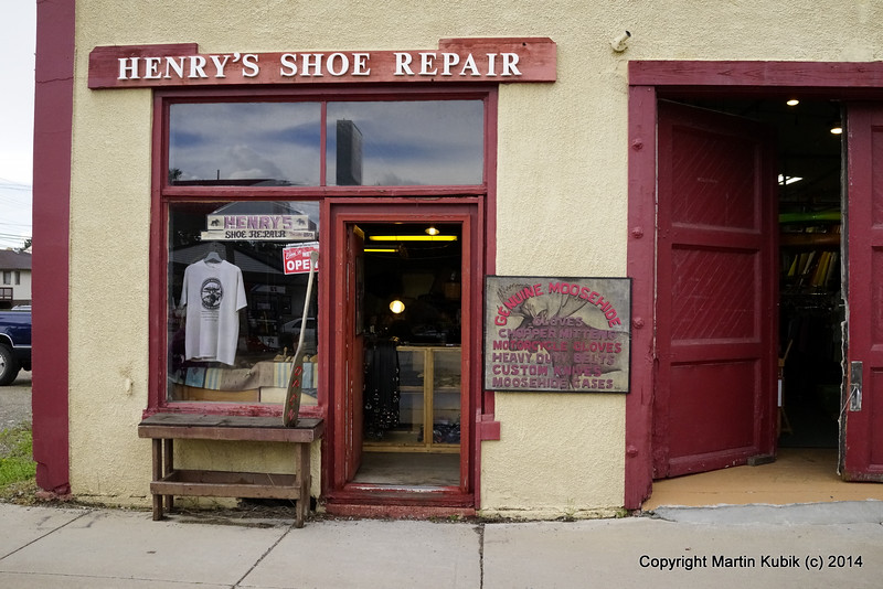 The leather strap on my  thirty five year old Duluth pack tore off.  Where does one go to have it repaired - while you wait?  Henry's Shoe Repair at Ely, Minnesota, canoe capital of the world. of course!