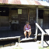 Dearne resting outside a 1800's Miner Hutt at the Herbertson Historical Village