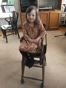 Each of the younger children tried the high chair in turn.