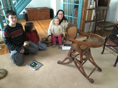 I invited this home-schooling family to come see the chair and study it as an example of American ingenuity.  We had fun together examining it closely, and I learned a few things from their observations and comments.  The chair has 4 positions.  In the high position, only the front wheels still roll; the back wheels are mounted slightly higher so the back legs rest directly on the ground.
