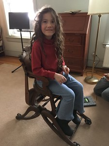 Even big sister fits in it.  (We lowered the chair for added stability before she tried it.)