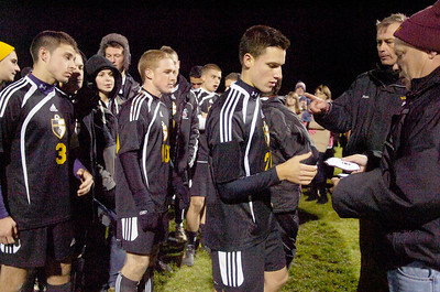 Ballston Spa teammate Dan Bortoloni receive their patches after their co-championship section 2 Class AA soccer game against Saratoga Springs Wednesday evening in Colonie. Photo Erica Miller 11/10/10 bspa_CoChamps6