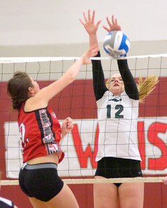 Shen's Lauren Rokjer blocks a shot by Baldwinsville's Paulina Rein during the Class AA Sectional Regional volleyball tournament Saturday at Union College. Ed Burke 11/13/10