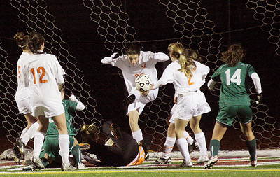 With her goalie on the ground and under pressure from Shenedehowa offense, Bethlehem's Briana Swete clears the ball from the net during the Section II Class AA girls soccer championship Wednesday at Stillwater. Ed Burke 11/10/10