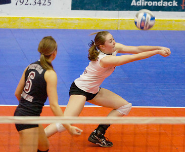Burnt Hills-Ballston Lake's Siena Wilder bumps the ball as the Spartans took on Wantagh during the state volleyball championships Saturday at the Glens Falls Civic Center. Ed Burke 11/20/10