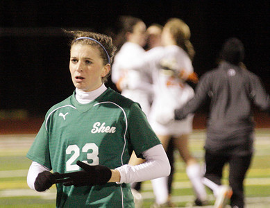 A dejected Alexandra Maguire leaves the field as Bethlehem players celebrate their Section II Class AA soccer title with a 1-0 victory over Shenendehowa Wednesday evening in Stillwater. Ed Burke 11/10/10