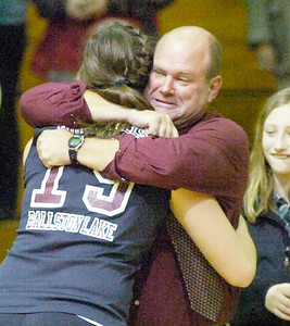 Maria Allocco gets a winning hug from coach Gary Bynon after the Burnt Hills-Ballston Lake Spartans beat Queenbury for the Section II Class A volleyball title Thursday evening in Niskayuna. Ed Burke 11/11/10