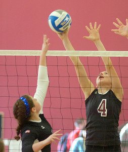BHBL's Natalie Ziskin gets the upper hand on Oswego's Cortnie Purce during the Class A Sectional Regional volleyball tournament Saturday at Union College. Ed Burke 11/13/10