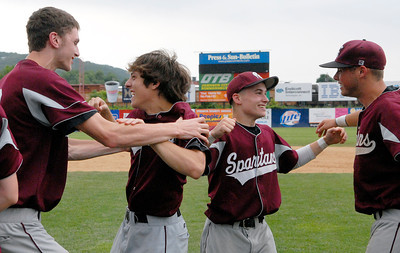 Burnt Hills-Ballston Lake Baseball teammates celebrate after their State Championship win against Pittsford Surtherland in Binghamton Sunday afternoon. Photo Erica Miller 6/12/11 spt_BHBLwin8_Mon