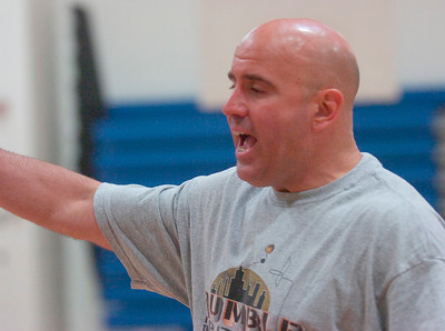 Saratoga's new varsity basketball coach Frank Mahoney runs drills Thursday for returning varsity players. Ed Burke 6/23/11