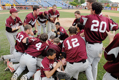 Burnt Hills-Ballston Lake Baseball teammates celebrate after their State Championship win against Pittsford Surtherland in Binghamton Sunday afternoon. Photo Erica Miller 6/12/11 spt_BHBLwin1_Mon
