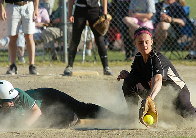 Shen's Katie Traver is safe at second as Bethlehem's Mary Beth Dombrowski tries to make the play during Friday's Class AA softball championship at Clifton Common. Ed Burke 6/3/11