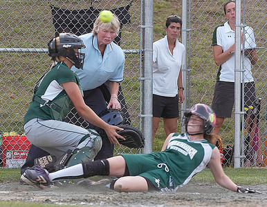 Greenwich's Abigail Dusha is safe at home as the ball gets away from Norwood-Norfolk catcher Carlea Weaver during regional Class C action Wednesday at Adirondack Sports Complex in Queensbury. Ed Burke 6/8/11