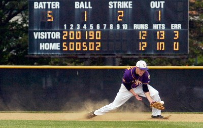 Saratoga Central Catholic Saints third baseman Dylan Anderson misses a ground ball during the bottom of the sixth inning during their State Semifinals against Chenango Valley at Binghamton University Saturday afternoon. Photo Erica Miller 6/11/11 spt_SpaSTATES7_Sun