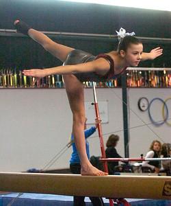 Saratoga's Francesca Mangino competes on the balance beam during Saturday's Saratoga Gymnastics Invitational. Ed Burke 1/7/12