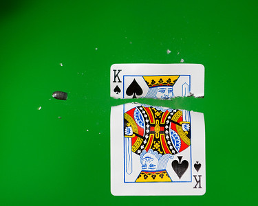 Playing card being shot by a .22 caliber bullet.