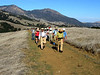 Mount Diablo's two peaks serve as a backdrop for the hiking party.