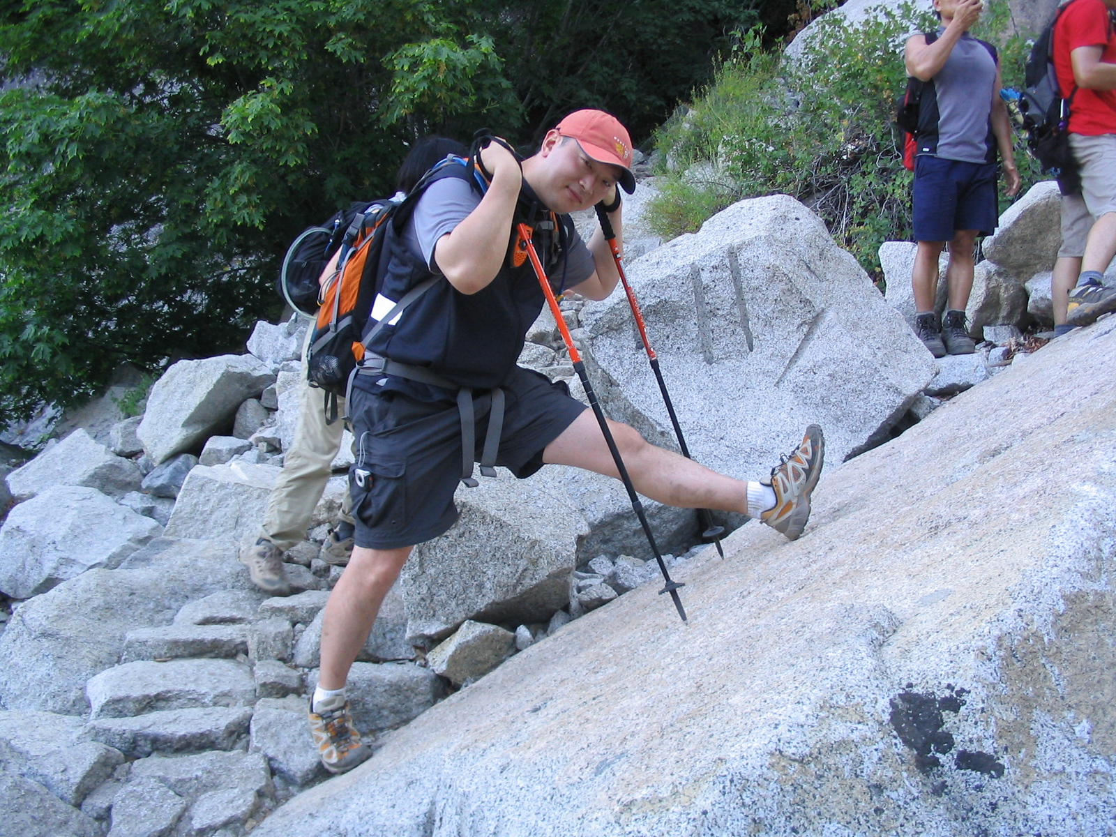 the granite stairs up to little yosemite valley was also quite steep, and we took several rest breaks.  here you can see alex streching and showing off his trekking poles.