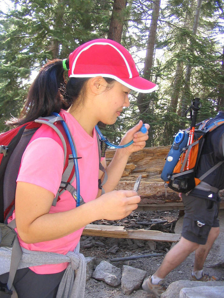 hydration is v. important on a hike like this, and a hydration pack with a tube sure helps!  i'd highly recommend getting one, as it encourages you to sip the water often, making it easier for the body to absorb.  grace shows us how as we begin to ascend the granite staircase on the dome of half dome.