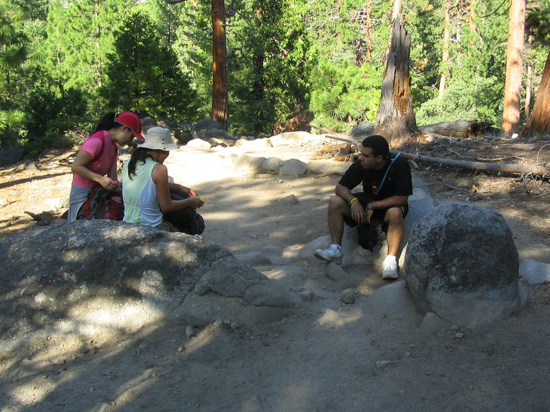 by 8:45, we had left little yosemite valley and were working our way to the granite stairs of the dome itself.  the trail gradually steepened, and we had to take the occasional break.  here you can see grace, jenni, and cris resting.