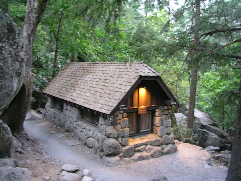 "photo courtesy of tom.  we arrived at the restroom at the vernal falls footbridge just after 6am (30 mins into our hike).  it was the only source of potable water on the trail, just  over one mile into our hike.  it was still before dawn--notice the lights in the bathroom.  i stopped to fill both of my camelbak bladders with water at the water station.     because previously, they had only been filled with ice and a minimal amount of drinking water.   no more ""light"" pack until i could drink most of the water."
