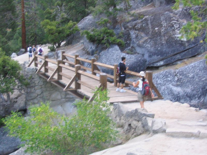 around 7am, we reached the nevada falls footbridge.  my picture is kinda blurry, so i'll also show you the picture tom took.