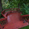 Our deck, now almost 20 yrs old and still sound, level, and beautiful, was freshly stained this summer by Sue.  This time she used opaque stain which should be longer lasting.  That's a brass sun dial given to Sue by her Dad many years ago.  In the background you can see the beautiful Pierce Park across the street below.