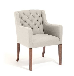 these dining chairs will tie in wiht the tufting likely on the sofas, and the legs are in the same wood as the sideboard's textured wood