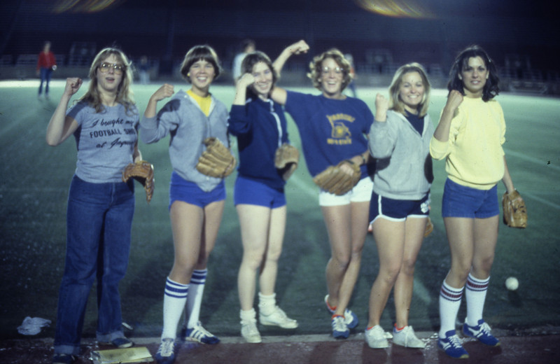Students posing for a photo at a softball game, 1978