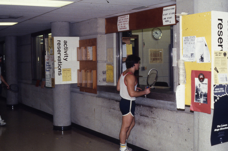 Student at activity reservation counter in Larkins Hall, 1983
