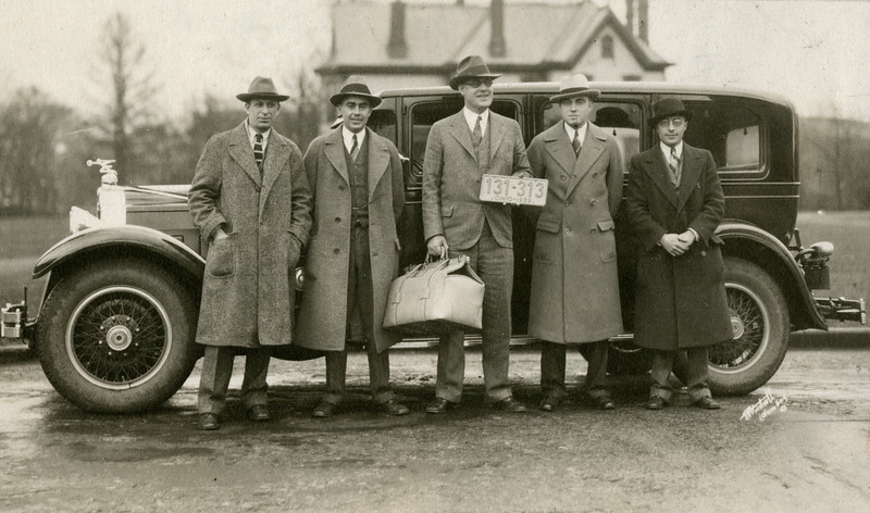 Wilce Retirement: Presented with Pockard Pigskin Medical Bag with Old Athletic Building in background, 1929