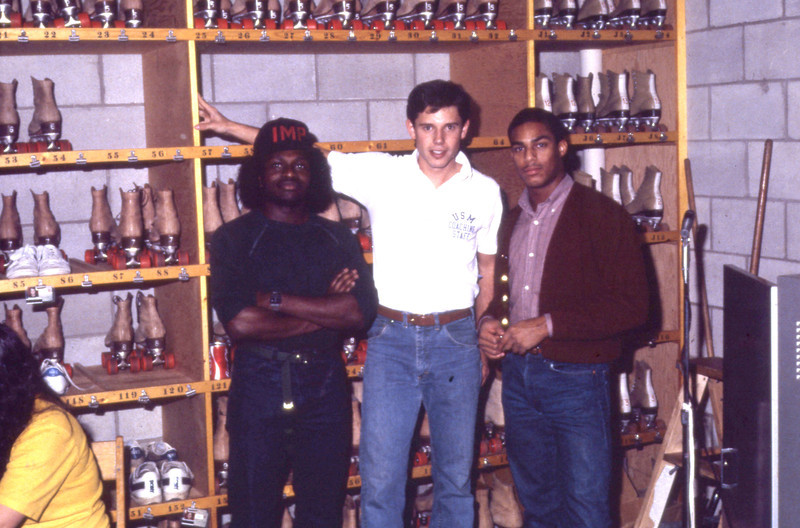 Group of students in rollerblade rental storage, 1983