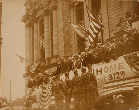 Newark's Irish born Mayor, Charles P. Gillen, front and center on the steps of City Hall, <br /> reviews the colors of the troops returning home in 1918.