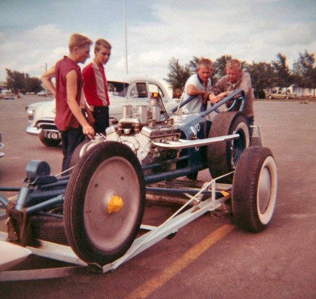Another unidentified Racer with onlookers
