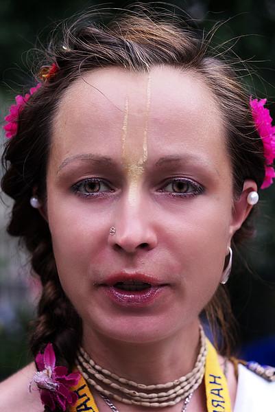 YOUNG WOMAN- HARE KRISHNA GROUP- UNION SQUARE<br /> LUMIX G1X- MINOLTA ROKKOR 40MM-(80MM-EFL) f2.8