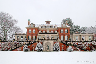 Westbury House during snowfall at Old Westbury Gardens. 2017 Christmas Tree in center.