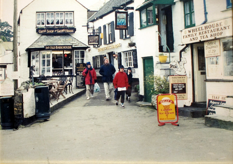 A picture of Polperro taken in 2002 on display at the Jamaica Inn Museum.   The previous picture was taken from the same place in about 1890<br /> Note that the pub is still called Three Pilchards.