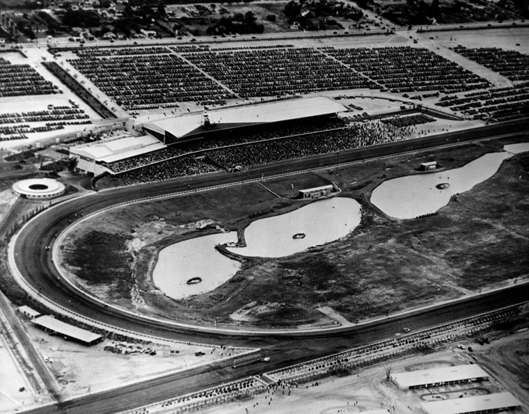 . Aerial view of Hollywood Park grandstand and racetrack, which was built in 1937. It was designed by architects Stiles O. Clements and Edward Huntsman-Trout.   (Los Angeles Public Library)