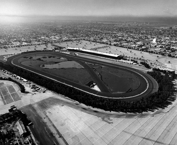 . Aerial view of Hollywood Park Racetrack in 1968. Built in 1937, the master plan was designed by architect Stiles O. Clements and landscape architect Edward Huntsman-Trout.  (Los Angeles Public Library)