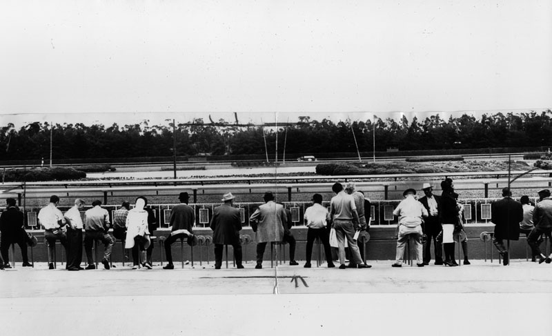 . Turf fans line the rail at Hollywood Park awaiting the start of the first race on May 11, 1968.   (Los Angeles Public Library)