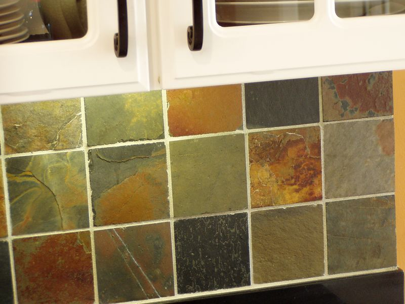 """Ruth and I installed this slate tile in April 2004.  We covered the """"backsplash"""" area above our granite counters in our kitchen.  It was the first time we've tried something like this.  This close up gives a good view of the variety of colors in the natural slate we chose.  The slate came from China."""