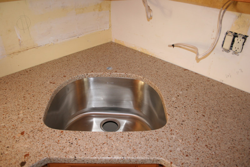 First counter top with ugly spot left front of sink.