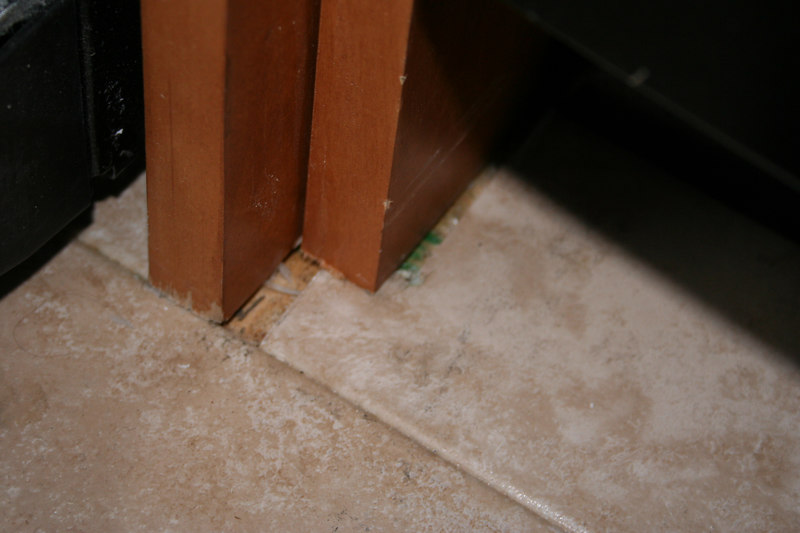 Punch List  Gaps between particions and floor tile.
