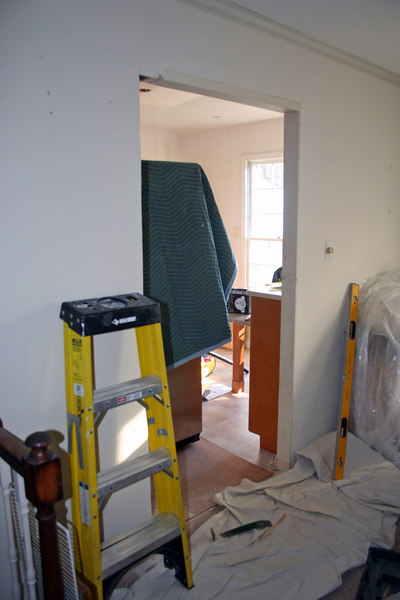Working to enlarge door between kitchen and dining room to solve problem with the refrigerator door.