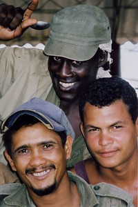 - Three Cuban farmers just in from the fields after a long work day.
